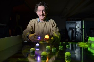 A team, under the direction of Assistant Professor Nicolaus Correll, is developing a swarm of ping-pong ball sized robots at the University of Colorado Boulder. The robots work in tandem with each other to solve tasks. (Photo by Casey A. Cass/University of Colorado)