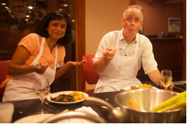 Sandhya bonding with colleagues over a culinary lesson at the 2016 department retreat