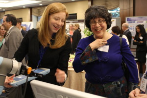 Amanda Edwards, of Johns Hopkins University, demonstrates the CoSTAR system to Deborah Lockhart of NSF.