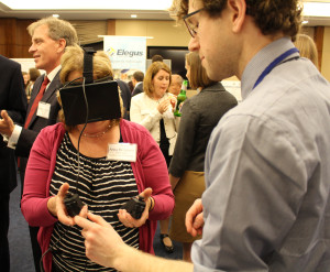 Colin Lea explains the virtual reality interface to Anita Benjamin of the American Mathematical Society.