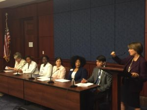 Sen. Klobuchar (D-MN) (at podium) introduces the first briefing of the Diversity in Tech caucus. Rebecca Wright (seated, third from right), represented CRA-W on the panel.