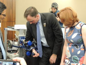 Rep. Pete Olson (R-TX) is shown the robotics demonstration by Marica O'Malley of Rice University.